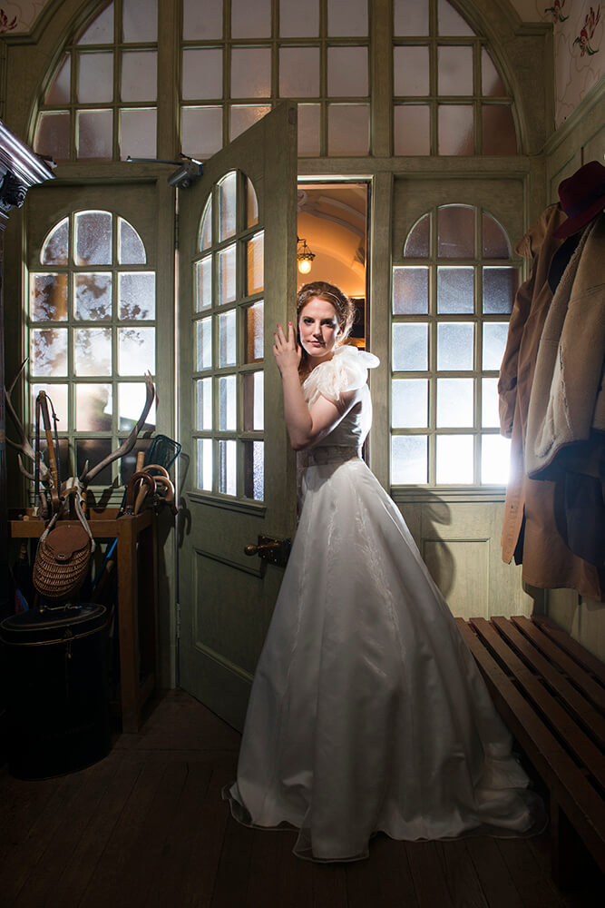 The cloakroom at Sorn Castle is not the most obvious choice for a location but adds lots of rustic charm. Photography by Ayrshire wedding photographer Richard Campbell