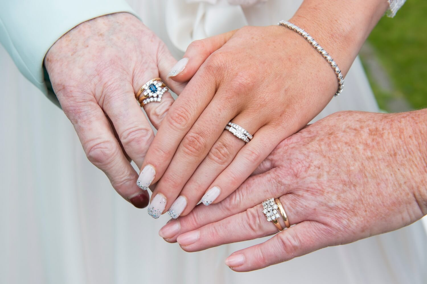 Wedding Photography of Rings and Hands showing Three Generations