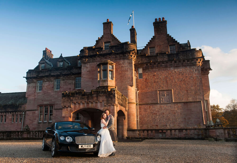 couple and wedding car at sorn castle ayrshire wedding photographers ayrshire ayr richard campbell photography