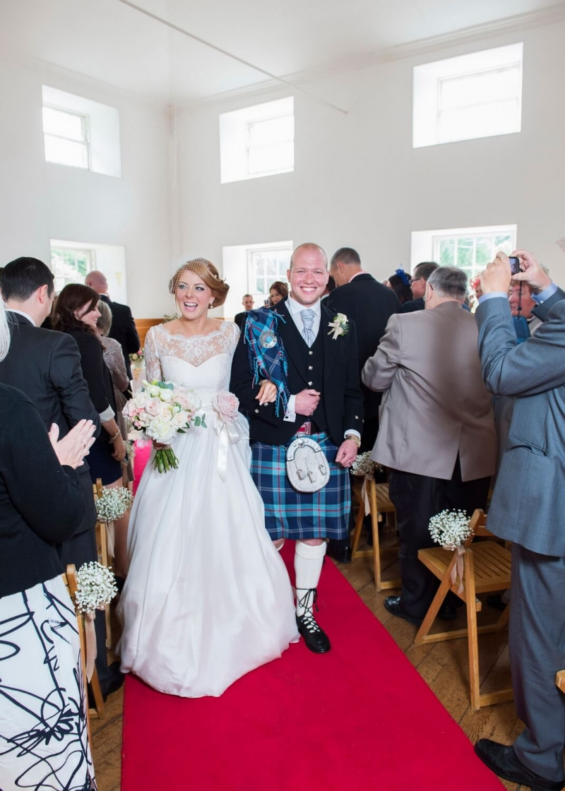 Bride and Groom Coming Down the Aisle at New Lanark