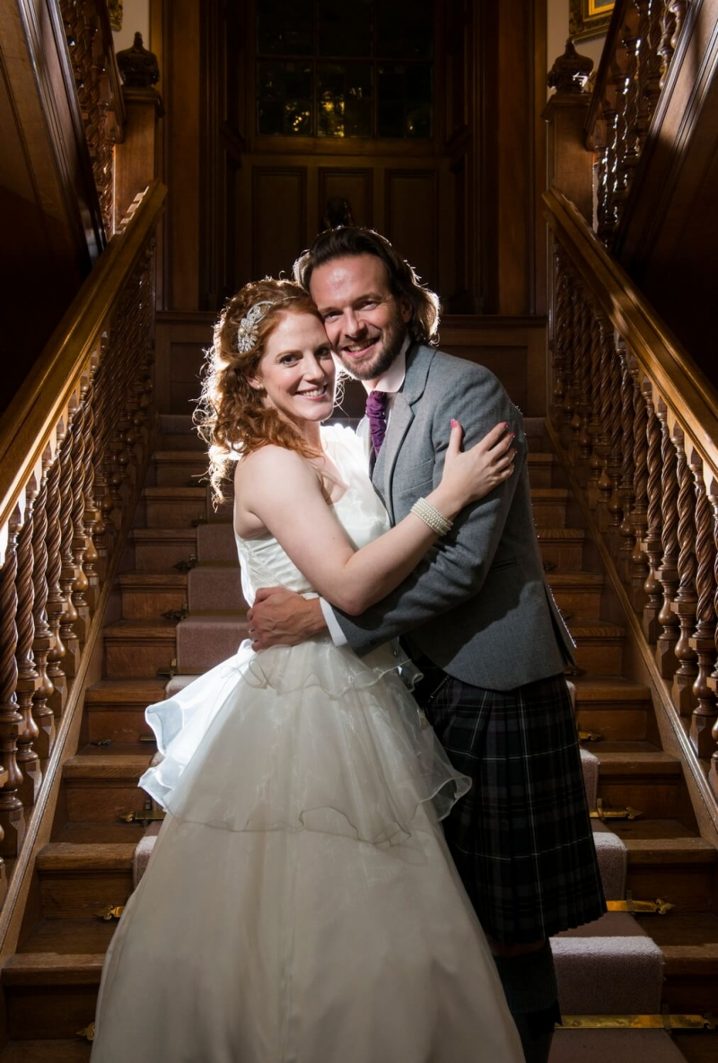 Bride and Groom on Staircase at Sorn Castle Ayrshire