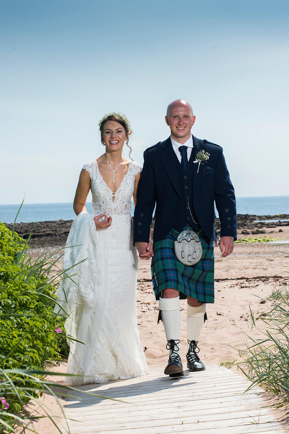 The Waterside hotel is very close to the beach which is perfect for fun wedding photographs.